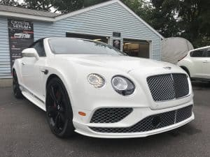 white Bentley detailed parked outside difiores detail