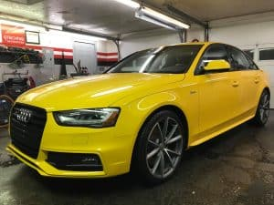 yellow audi parked inside the difiore detail garage