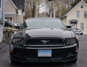 black mustang in driveway of difiore's detail that was detailed