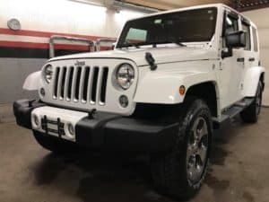 white jeep wrangler with a full paint correction and detail