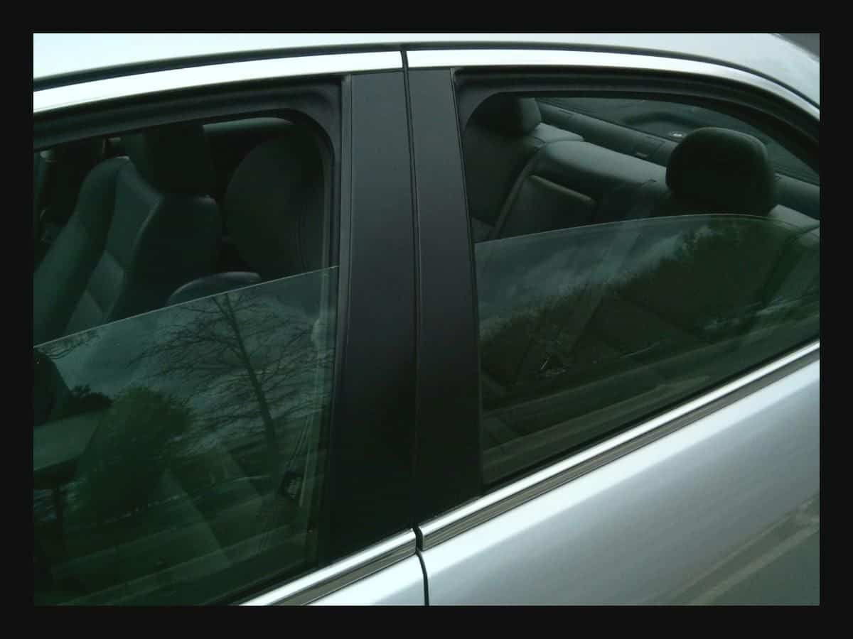 Car with windows cracked open to off-gas