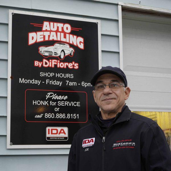 joe difiore of difiores detail standing next to his business sign